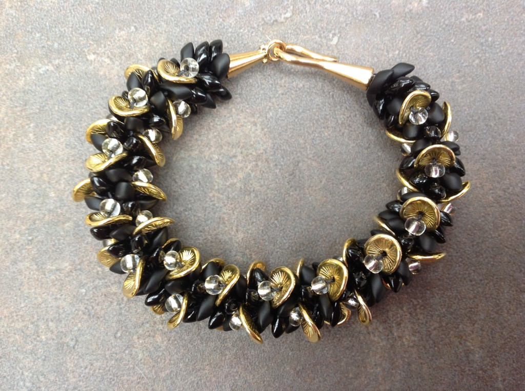 Kumihimo bracelet made with wavy disk beads
