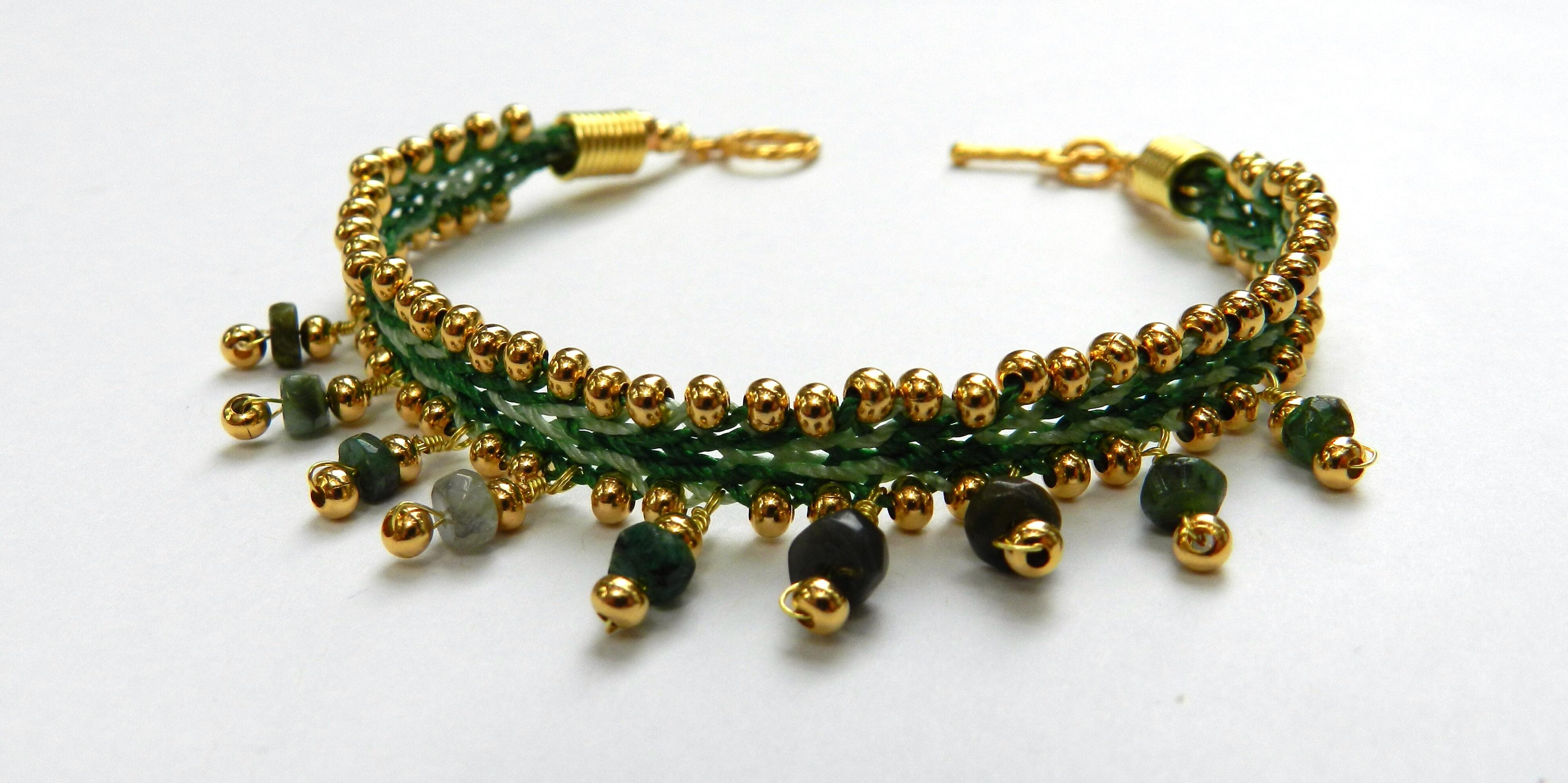 Kumihimo made using metal seed beads and emeralds